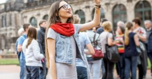 A woman standing by a group pointing